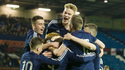 Craig Wighton (9) is mobbed by his team mates after scoring Scotland's second goal of the game.   Copyright snspix.com